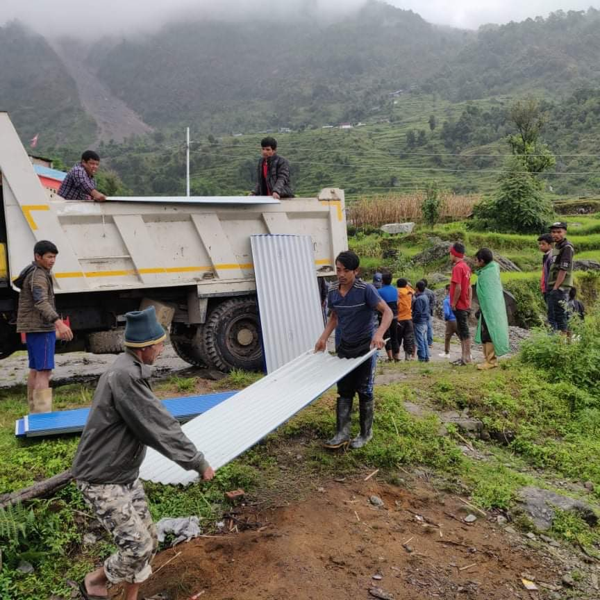 Creative Hands supported Zinc sheets to who looses their houses by flooding and landslides in Dolakha District Nepal